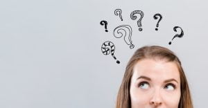 Girl with question marks around head